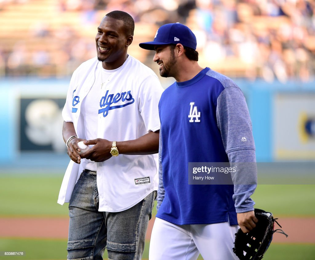 Antonio Gates of the Los Angeles Chargers smiles with Adrian Gonzalez #23 of the Los Angeles Dodgers after throwing out a ceremonial first pitch before the game against the New York Mets at Dodger Stadium on June 22, 2017 in Los Angeles, California.