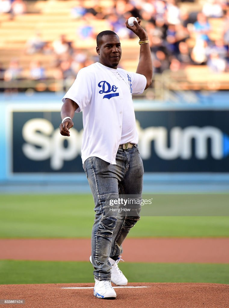 Antonio Gates of the Los Angeles Chargers throws out a ceremonial first pitch before the game between the New York Mets and the Los Angeles Dodgers at Dodger Stadium on June 22, 2017 in Los Angeles, California.