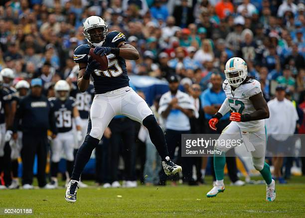 Antonio Gates of the San Diego Chargers catches a pass as Kelvin Sheppard of the Miami Dolphins defends during a game at Qualcomm Stadium on December...
