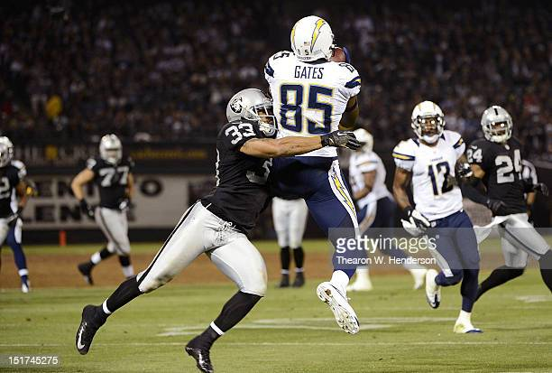 Antonio Gates of the San Diego Chargers catches a seventeen yard pass over Tyvon Branch of the Oakland Raiders in the second quarter of the season...