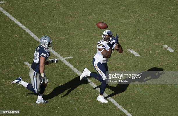 Antonio Gates of the San Diego Chargers catches a touchdown pass in front of Sean Lee of the Dallas Cowboys en route to the Chargers 3021 victory on...