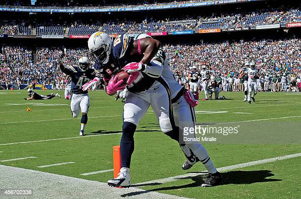 Antonio Gates of the San Diego Chargers catches a touchdown pass against Antonio Allen the New York Jets during their NFL game at Qualcomm Stadium on...