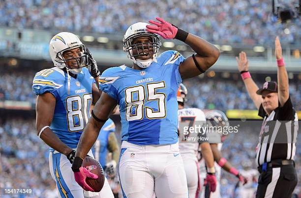 Antonio Gates of the San Diego Chargers celebrates his first quarter touchdown against the Denver Broncos as teammate Malcom Floyd looks on during...
