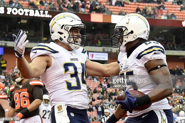 Antonio Gates of the San Diego Chargers celebrates with Derek Watt after catching a 1 yard touchdown pass in the first quarter against the Cleveland...