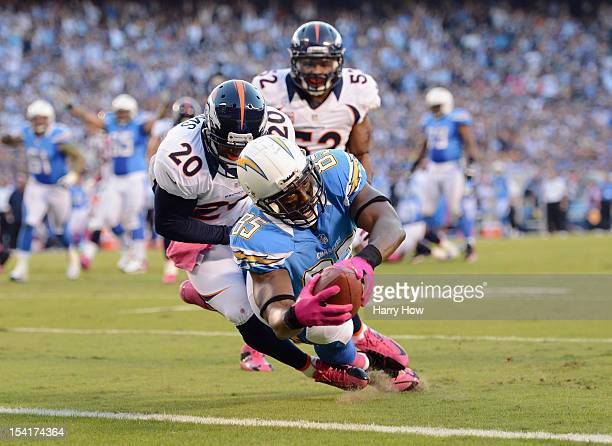 Antonio Gates of the San Diego Chargers dives into the end zone for a touchdown in the first quarter past Mike Adams of the Denver Broncos during the...