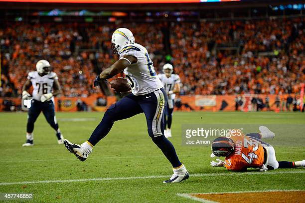 Antonio Gates of the San Diego Chargers makes a touchdown catch while being guarded by TJ Ward of the Denver Broncos The Denver Broncos played the...