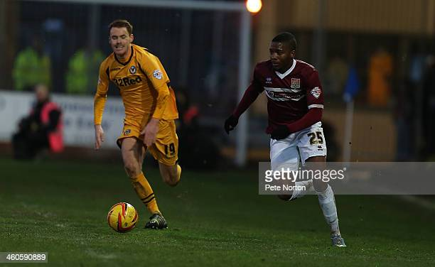 Antonio German of Northampton Town moves forward with the ball from Tom Naylor of Newport County AFC during the Sky Bet League Two match between...
