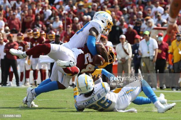 Antonio Gibson of the Washington Football Team fumbles against the Los Angeles Chargers during the fourth quarter at FedExField on September 12, 2021...