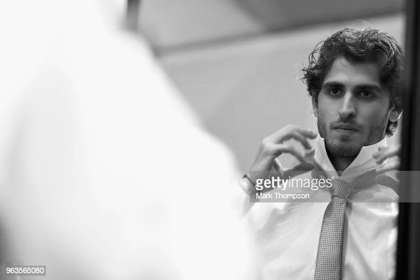 Antonio Giovinazzi of Italy and Ferrari prepares backstage at the Amber Lounge Fashion show during previews ahead of the Monaco Formula One Grand...