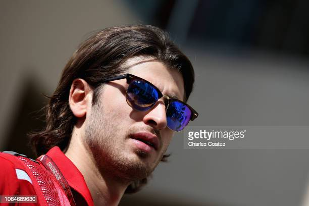 Antonio Giovinazzi of Italy and Sauber F1 walks in the Paddock before final practice for the Abu Dhabi Formula One Grand Prix at Yas Marina Circuit...