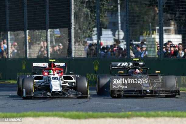 Antonio Giovinazzi of Italy drives the Alfa Romeo Racing C38 alongside Kevin Magnussen of Denmark who drives the Rich Energy Haas F1 Team VF19 during...