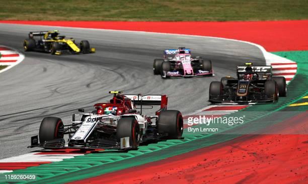 Antonio Giovinazzi of Italy driving the Alfa Romeo Racing C38 Ferrari leads Kevin Magnussen of Denmark driving the Haas F1 Team VF19 Ferrari Sergio...