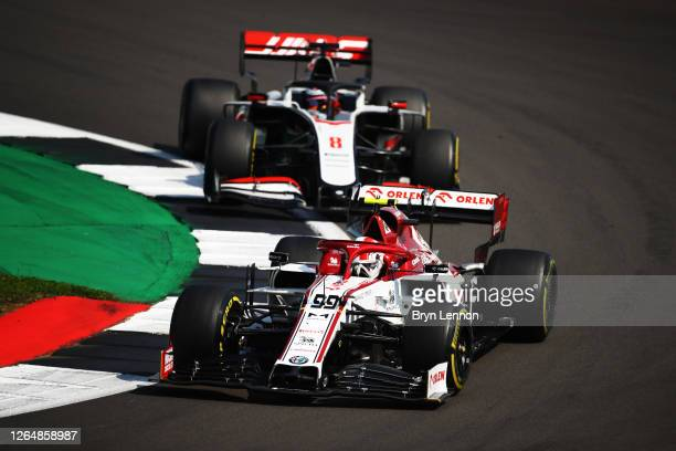 Antonio Giovinazzi of Italy driving the Alfa Romeo Racing C39 Ferrari leads Romain Grosjean of France driving the Haas F1 Team VF-20 Ferrari during...