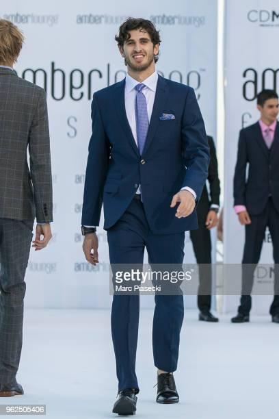 Antonio Giovinazzi walks the runway during Amber Lounge U*NITE 2018 in aid of Sir Jackie Stewart's foundation 'Race Against Dementia' at Le Meridien...