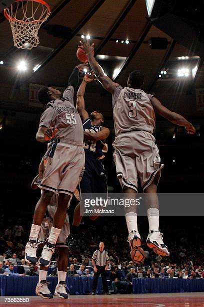 Antonio Graves of the Pittsburgh Panthers goes to the hoop against DaJuan Summers and Roy Hibbert of the Georgetown Hoyas during the final of the Big...