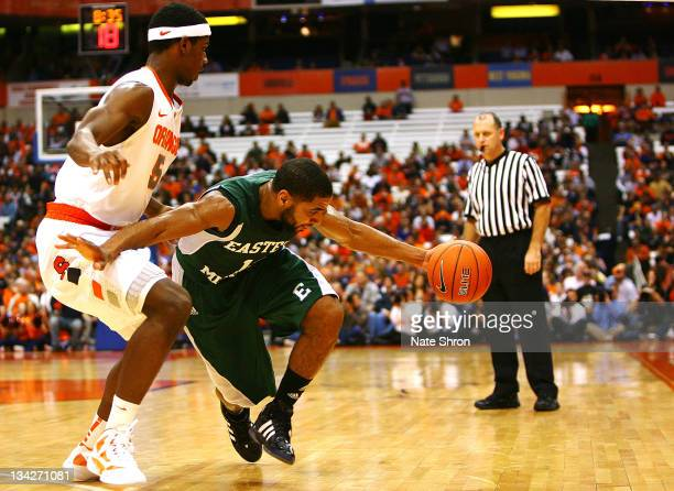 Antonio Green of the Eastern Michigan Eagles dribbles around C.J. Fair of the Syracuse Orange during the game at the Carrier Dome on November 29,...
