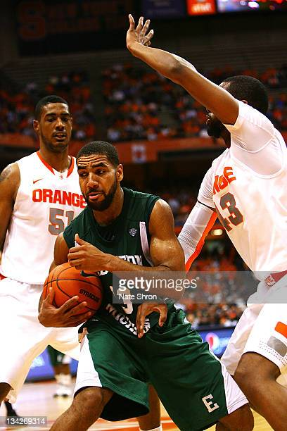 Antonio Green of the Eastern Michigan Eagles struggles as he attempts to hold onto the ball against James Southerland of the Syracuse Orange during...