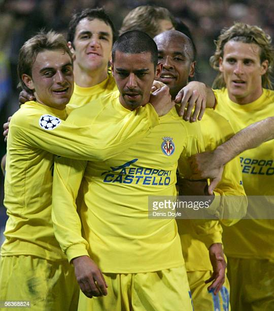 Antonio Guayre of Villarreal celebrates with teammates after scoring a goal during the UEFA Champions League Group D match between Villarreal and...