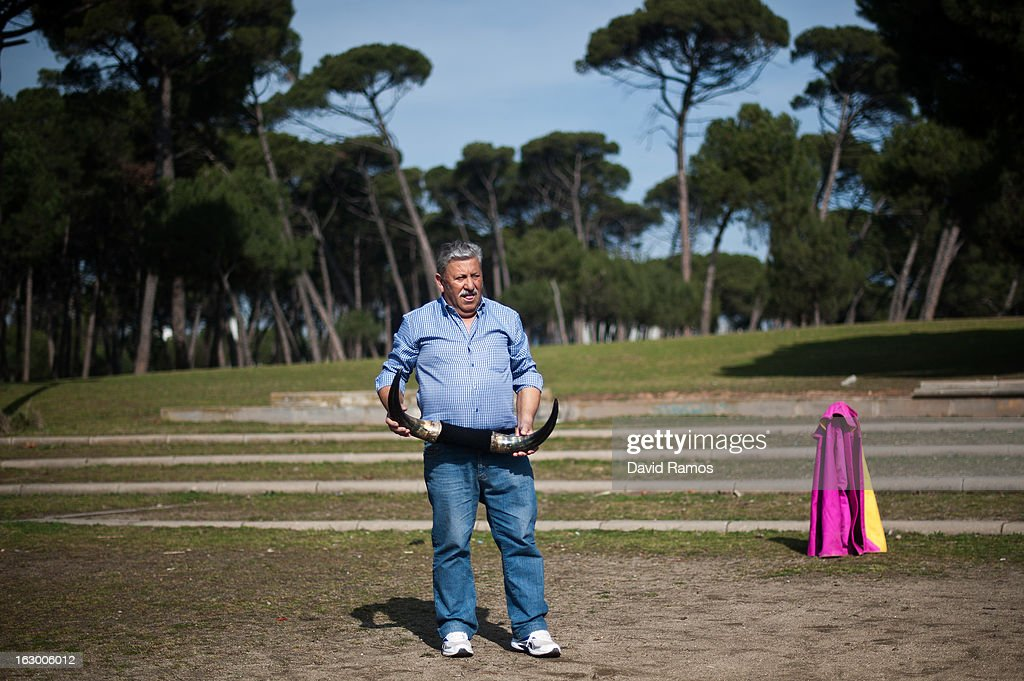 Antonio Guillen, 67, holds bull horns as he practices bullfighting in a city park in Santa Perpetua de la Mogoda on March 3, 2013 in Barcelona, Spain. On February 12 the Spanish Parliament accepted a petition from bullfight supporters asking for the sport to become a key part of the Spain's cultural heritage. The petition, of 590,000 signatures, has been promoted by the Federation of Bullfighting Entities of Catalonia. The last bullfight in Catalonia was held in September 25, 2011.Ê
