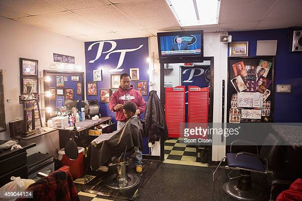 Antonio Henley cuts a customer's hair at the Prime Time Barber and Beauty shop on West Florissant Street November 15 2014 in Ferguson Missouri...