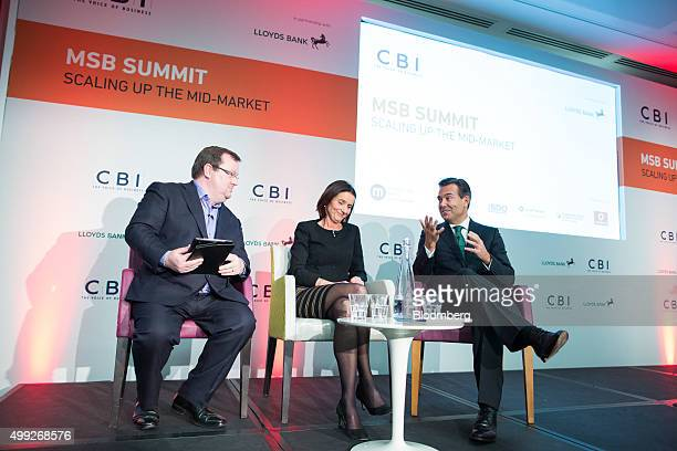 Antonio HortaOsorio chief executive officer of Lloyds Banking Group Plc right gestures as he speaks during a panel discussion with Carolyn Fairbairn...