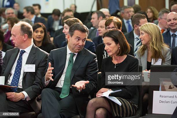 Antonio HortaOsorio chief executive officer of Lloyds Banking Group Plc left gestures as he speaks to Carolyn Fairbairn director general of...