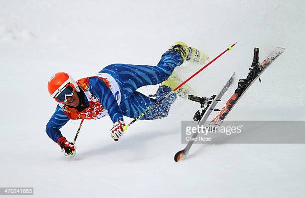Antonio Jose Pardo Andretta of Venezuela falls during the Alpine Skiing Men's Giant Slalom on day 12 of the Sochi 2014 Winter Olympics at Rosa Khutor...