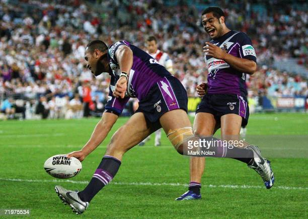 Antonio Kaufusi of the Storm scores as Adam Blair celebrates during the NRL Second Preliminary Final match between the Melbourne Storm and the St...