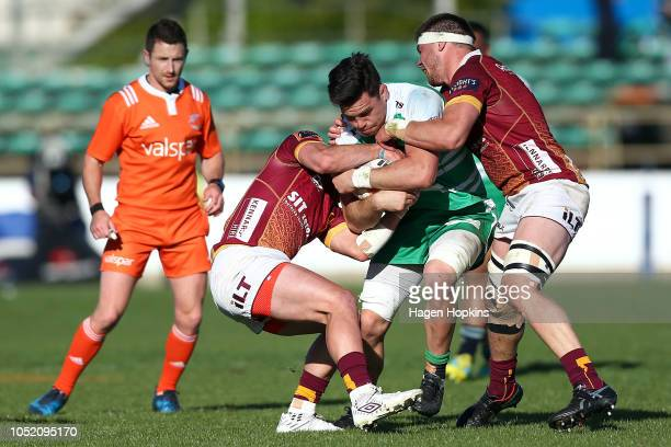 Antonio Kiri Kiri of Manawatu is tackled by Phil Halder and Nico Costa of Southland during the round nine Mitre 10 Cup match between Manawatu and...