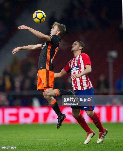 Antonio Latorre Grueso ''Lato'' of Valencia CF controls the ball beside Koke Resurreccion of Atletico de Madrid during the La Liga match between...