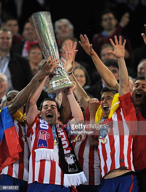 Antonio Lopez of Atletico Madrid lifts the UEFA Europa League trophy following his team's victory after extra time at the end of the UEFA Europa...