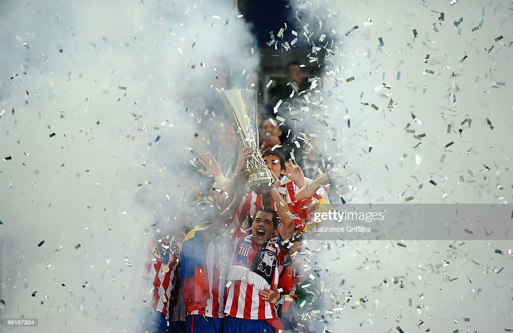 Antonio Lopez of Atletico Madrid lifts the UEFA Europa League trophy following his team's victory after extra time at the end of the UEFA Europa League final match between Atletico Madrid and Fulham at HSH Nordbank Arena on May 12, 2010 in Hamburg, Germany.