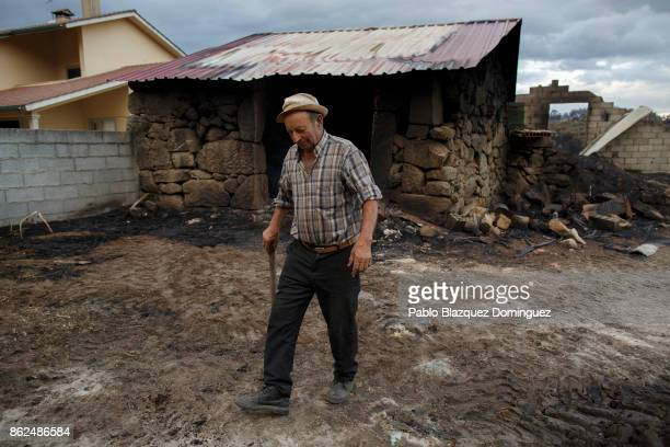 Antonio Lopez walks next to his cattle stable where his four cows died during a wildfire in the village of Vila Nova near Vouzela on October 17 2017...