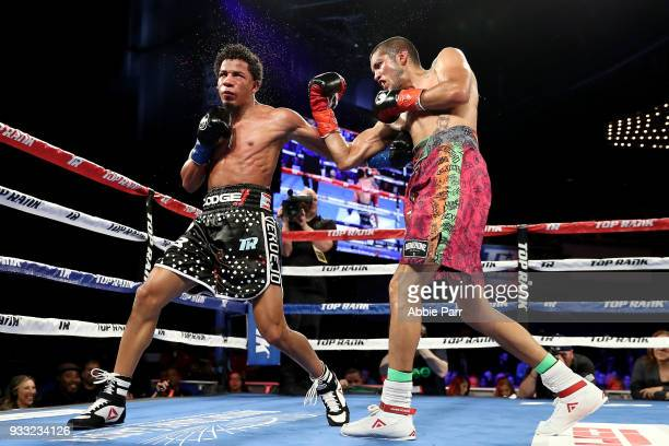 Antonio Lozada Jr punches Felix Verdejo during their lightweight fight fight at The Theatre at Madison Square Garden on March 17 2018 in New York City