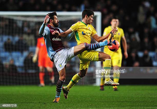 Antonio Luna of Aston Villa challenges Ryan Flynn of Sheffield United during the Budweiser FA Cup third round match between Aston Villa and Sheffield...