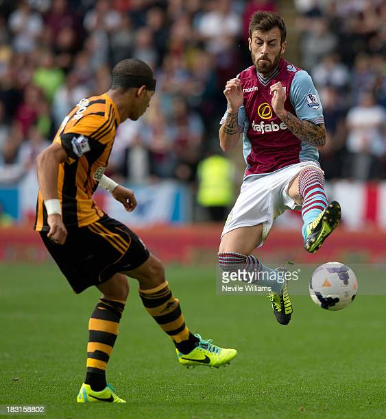 Antonio Luna of Aston Villa is challenged by Liam Rosenior of Hull City during the Barclays Premier League match between Hull City and Aston Villa at...