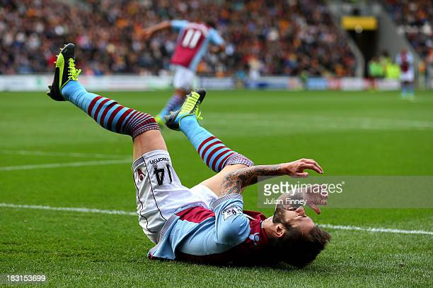 Antonio Luna of Aston Villa reacts after a missed chance on goal during the Barclays Premier League match between Hull City and Aston Villa at KC...