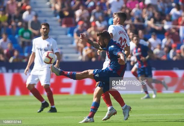 Antonio Luna of Levante UD and Andre Silva of Sevilla FC during the La Liga match between Levante UD and Sevilla FC at Ciutat de Valencia Stadium on...