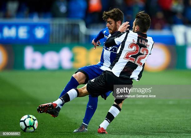 Antonio Luna of Levante UD duels for the ball with Ibai Gomez of Deportivo Alaves during the La Liga match between Deportivo Alaves and Levante UD at...