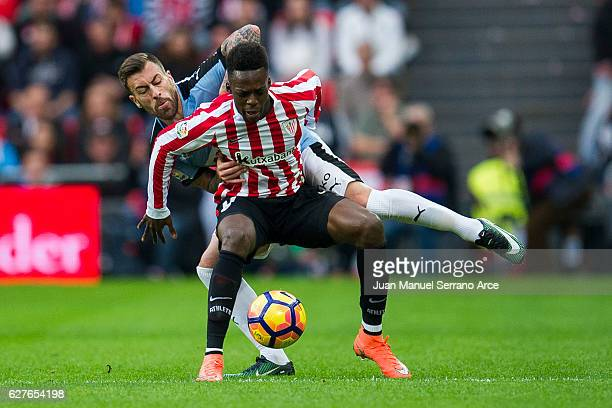 Antonio Luna of SD Eibar competes for the ball with Inaki Willams of Athletic Club during the La Liga match between Athletic Club Bilbao and SD Eibar...