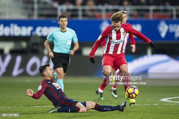 Antonio Luna of SD Eibar duels for the ball with Antoine Griezmann of Atletico Madrid during the La Liga match between SD Eibar and Atletico Madrid...