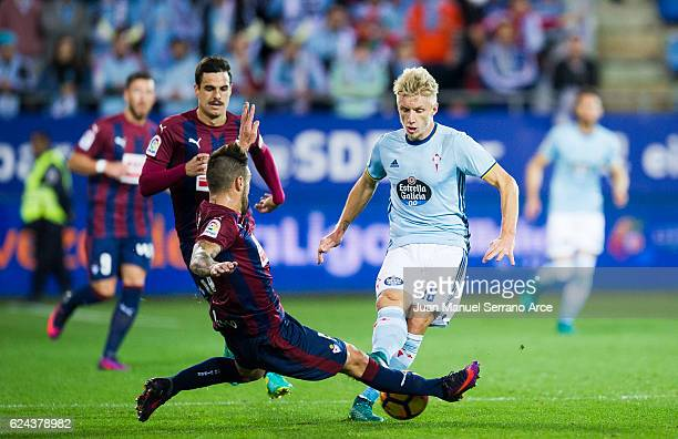 Antonio Luna of SD Eibar duels for the ball with Daniel Wass of RC Celta de Vigo during the La Liga match between SD Eibar and RC Celta de Vigo at...