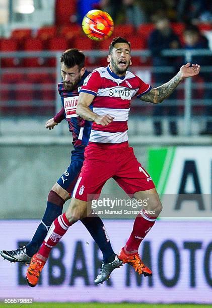 Antonio Luna of SD Eibar duels for the ball with Edgar Mendez of Granada CF during the La Liga match between SD Eibar and Granada CF at Ipurua...