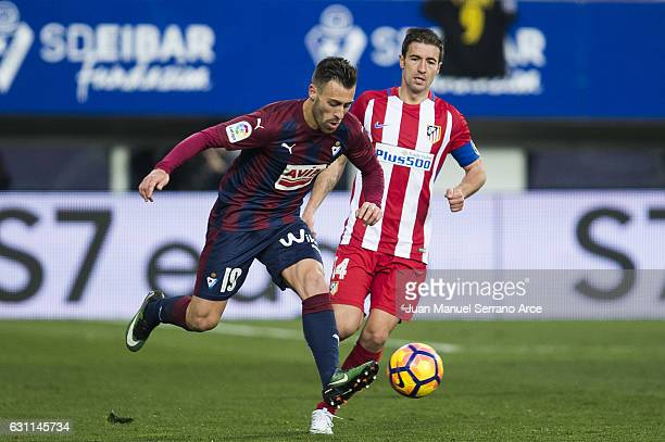 Antonio Luna of SD Eibar duels for the ball with Gabi Fernandez of Atletico Madrid during the La Liga match between SD Eibar and Atletico Madrid at...