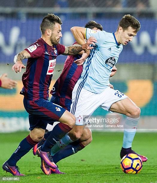 Antonio Luna of SD Eibar duels for the ball with Josep Sene of RC Celta de Vigo during the La Liga match between SD Eibar and RC Celta de Vigo at...