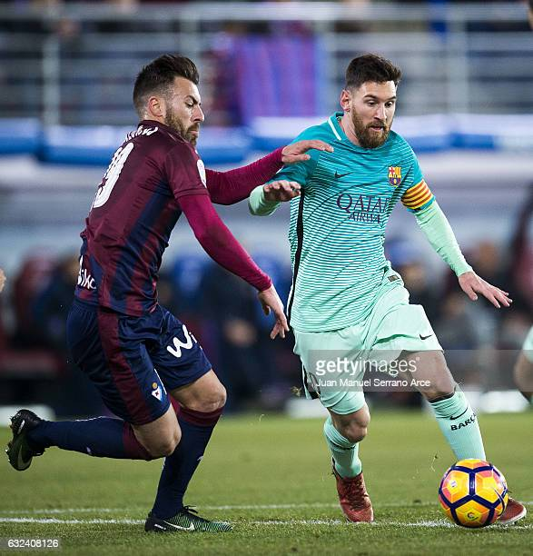 Antonio Luna of SD Eibar duels for the ball with Lionel Messi of FC Barcelona during the La Liga match between SD Eibar and FC Barcelona at Ipurua...