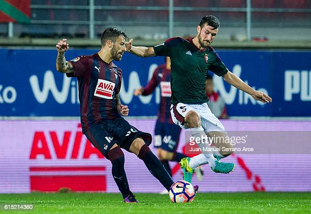 Antonio Luna of SD Eibar duels for the ball with Oier Sanjurjo of CA Osasuna during the La Liga match between SD Eibar and CA Osasuna at Ipurua...
