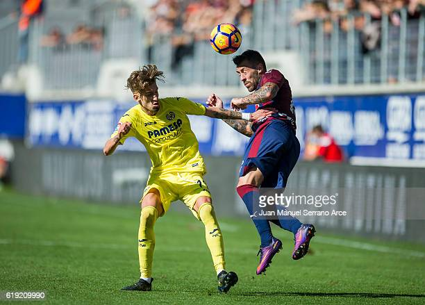 Antonio Luna of SD Eibar duels for the ball with Samuel Castillejo of Villarreal CF during the La Liga match between SD Eibar and Villarreal CF at...