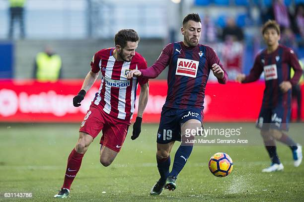 Antonio Luna of SD Eibar duels for the ball with Saul Niguiz of Atletico Madrid during the La Liga match between SD Eibar and Atletico Madrid at...