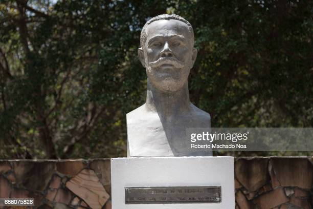 Antonio Maceo bronze statue in Cuban Memorial Park White stone bust memorial in front of a stone wall